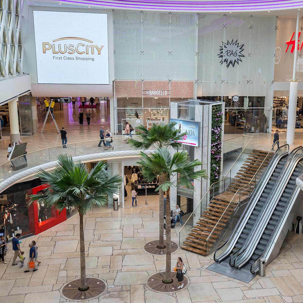 Pronaturstein - Österreich - Casa Sasso Steinmetz GmbH - Projekt - PlusCity – First Class Shopping veredelt mit Naturstein